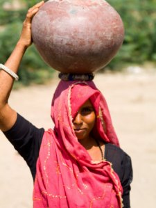 #Waterisjobs: A women carrying water in rural India