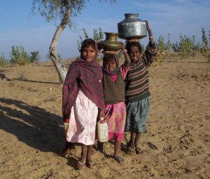 Girls fetching water©GlobalGiving.org